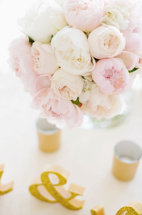 a gorgeous lush wedding centerpiece of white and blush peonies is a lovely idea for a summer wedding and is easy to make