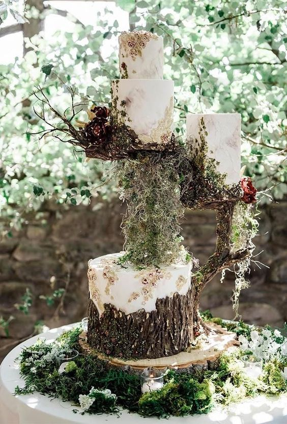a jaw-dropping assortment of enchanted forest wedding cakes covered with buttercream, with bark and blooms, with moss and branches