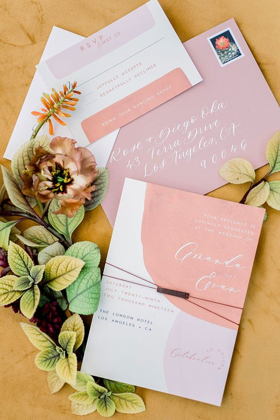 a lovely abstract wedding inivtations in peachy and pale pink, with calligraphy and modern letters is a cool solution for spring or summer