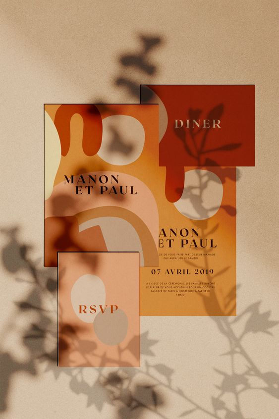 a lovely modern abstract invitation set in burgundy, rust, mustard and pink is a lovely idea for a bold summer or fall wedding