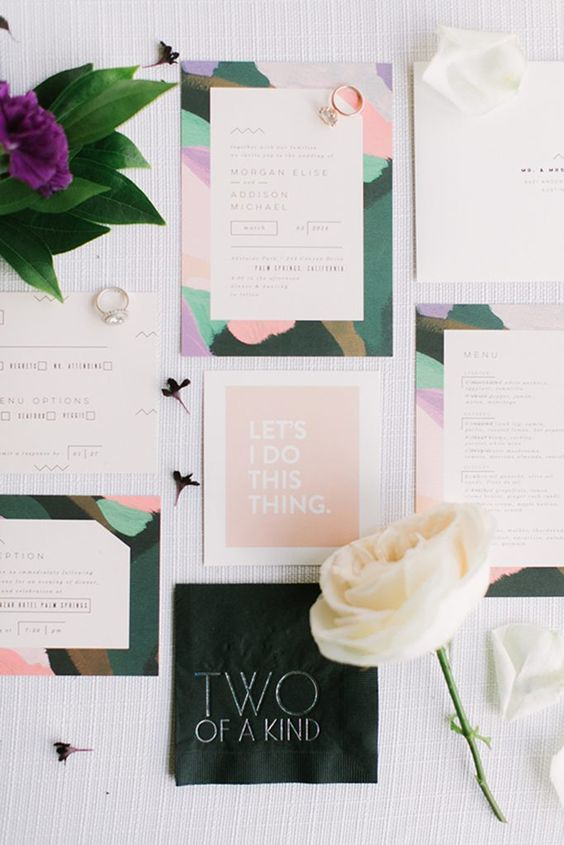 a lovely modern summer wedding invitation suite with purple, green and pink abstract prints is a fun idea for your wedding