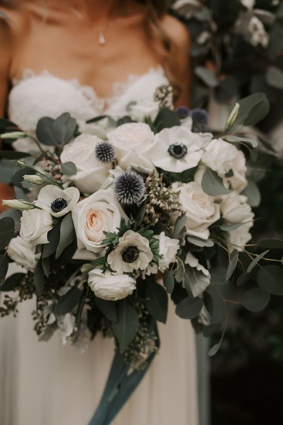 a lovely wedding bouquet of white roses, anemones, allium and eucalyptus and blue ribbons is amazing for spring or summer