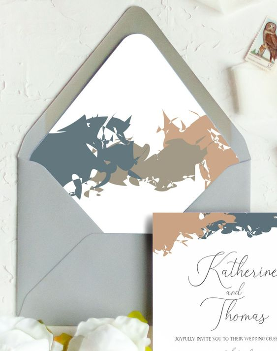 a modern abstract wedding invitaiton suite in navy, green, tan and with a grey envelope is a cool and bold idea