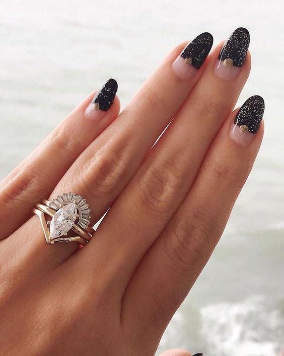 a refined stacked engagement ring with a central statement diamond one, an arched diamond ring and a simple lower one
