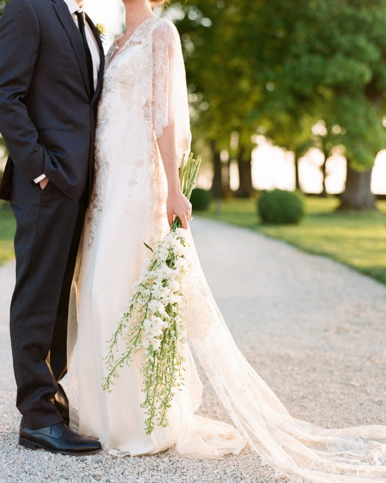 a romantic bridal look finished with a long stem white delphinium wedding bouquet is a gorgeous idea for a spring or summer bride