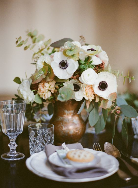 a gorgeous centerpiece with lots of white flowers