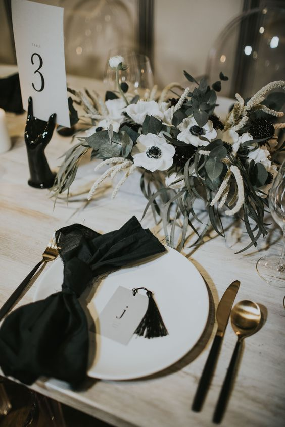 a stylish wedding centerpiece of white anemones, astilbe and greenery is a very elegant idea for a refined modern wedding