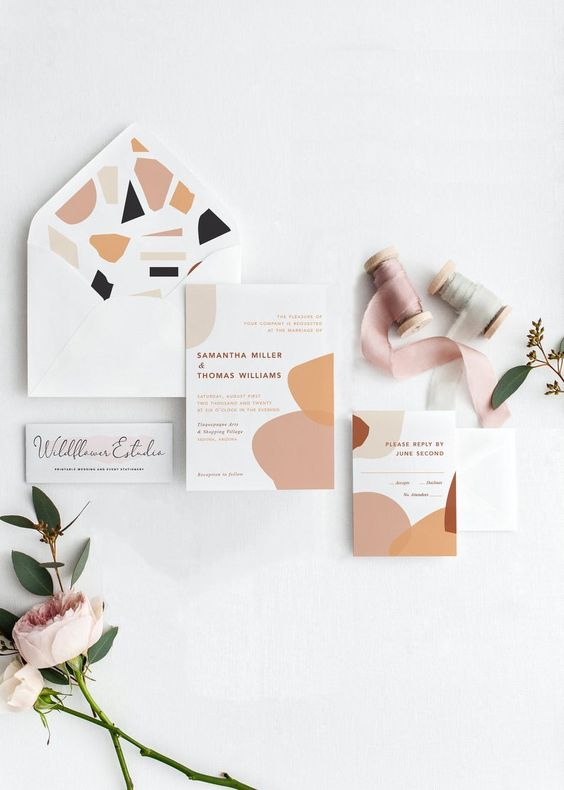 a subtle wedding invitation suite with pink, rust, black and grey touches inspired by terrazzo is great for spring or summer