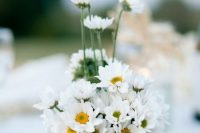 a vintage floral teacup with some chamomiles is a very cute and delicate idea, especially cool for a summer wedding