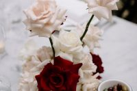 a whimsical blush and red rose wedding centerpiece is a lovely idea that will always catch an eye due to the shape and contrast