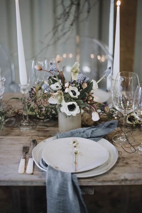 a whimsy wedding centerpiece of white anemones, blue bulbs, greenery and privet berries is a beautiful idea for a spring wedding