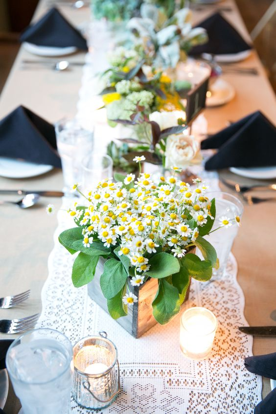 a wooden planted with daisies and some foliage is a cute and bright solution for a laid-back summer wedding