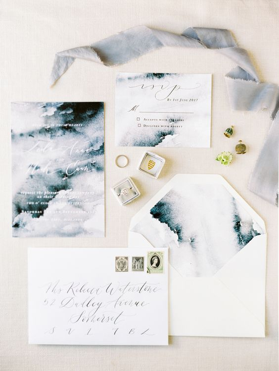an abstract watercolor grey wedding invitation suite with white calligraphy is a dreamy idea for a winter wedding