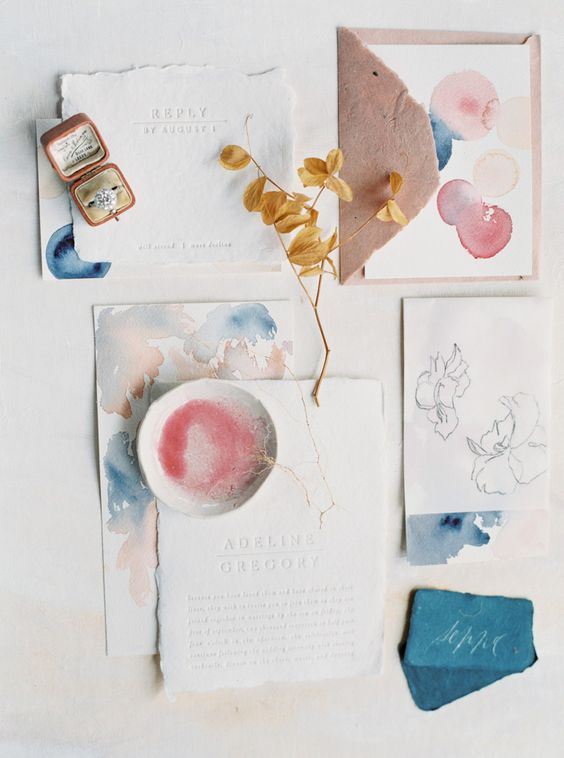 an abstract watercolor wedding stationary suite in blue, pink and with a raw edge is a beautiful idea for a spring or summer wedding