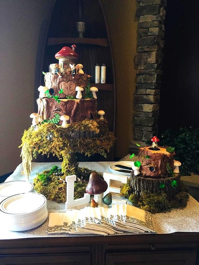 enchanted forest wedding cakes with sugar bark, mushrooms, greenery and tree stumps covered with moss