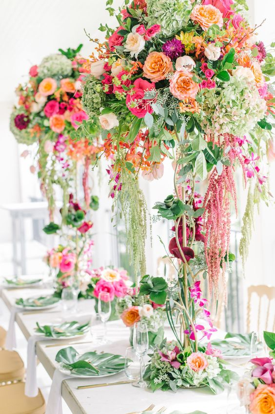 jaw-dropping secret garden wedding centerpieces of greenery and lots of colorful blooms, from bottom to the top are fantastic