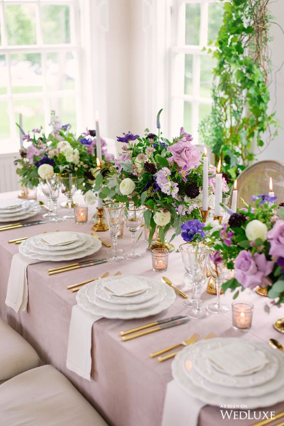 refined secret garden wedding centerpieces of white, lilac and purple blooms and greenery plus candles are amazing