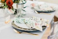 02 a beautiful and simple modern bridal shower tablescape with neutral porcelain and floral print napkins, bold blooms and greenery