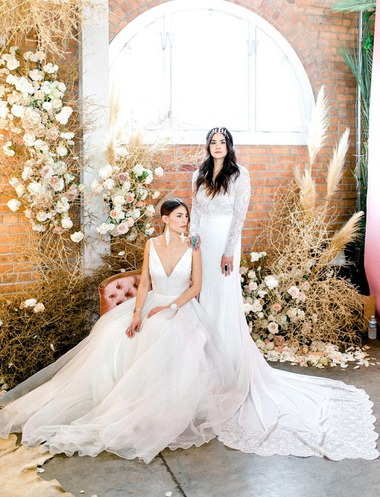 a bold and refined wedding altar with lots of dried foliage, pampas grass and overgrown blush and white blooms is wow