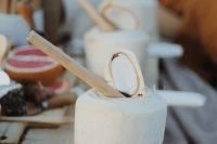 02 coconut drinks with bamboo straws are great eco-friendly wedding favors for a tropical or destination wedding