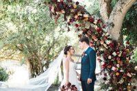 a fall wedding altar made of a living tree