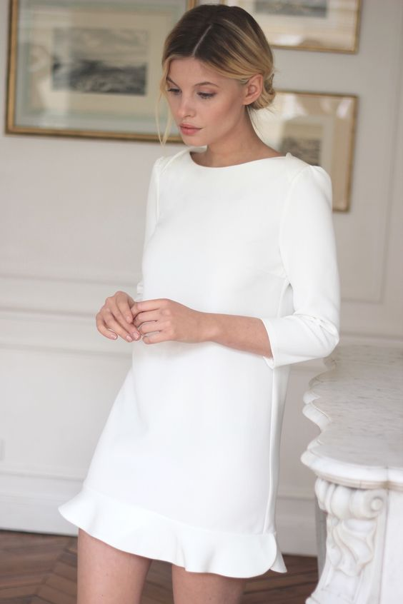 a very cool and simple plain mini wedding dress with a high neckline and short sleeves plus a ruffle edge is a stylish casual idea