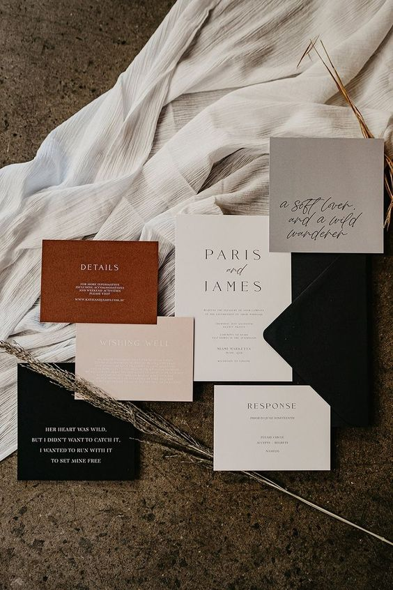 a stylish and cool modern fall wedding invitation suite with blush, black, rust and grey cards, black envelopes and calligraphy