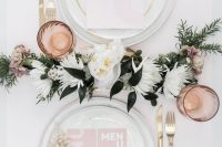 06 a delicate and elegant modern bridal shower tablescape with neutral porcelain, pink stationery, gold cutlery, a floral table runner and pink glasses
