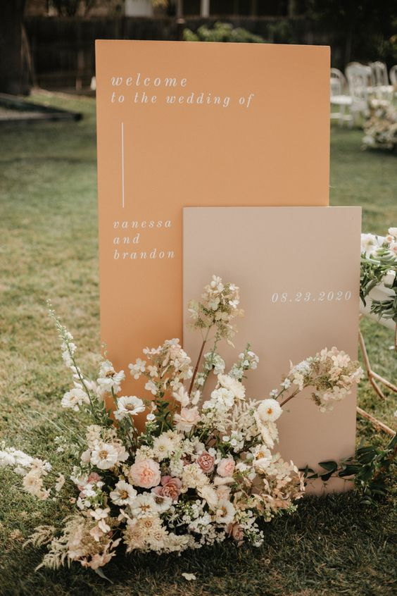chic modern fall wedding signage in blush and rust, with pastel blooms and some greenery looks gorgeous and very stylish
