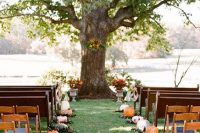 fall wedding ceremony space with lots of pumpkins