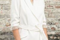 07 a white blazer mini wedding dress with a lace edge, short sleeves, a sash and statement accessories for a casual wedding