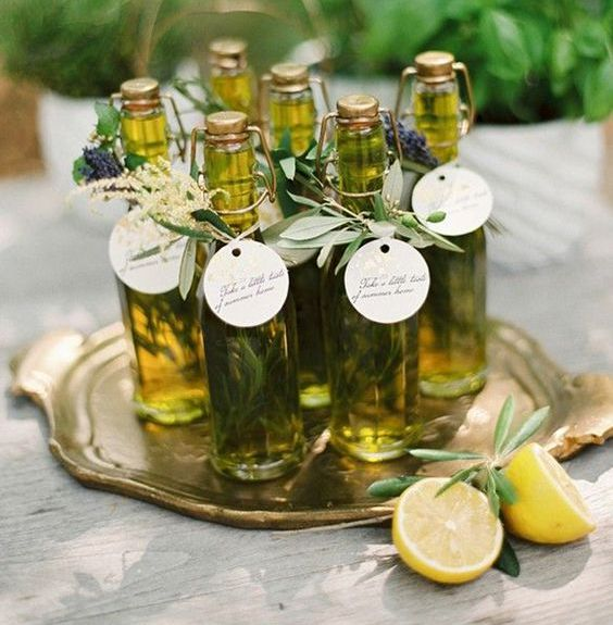 olive oil with herbs and tags with grasses is a very cool and very eco-friendly wedding favor that is also very good for health