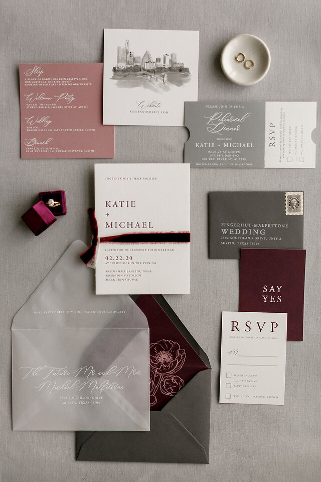 a cool modern fall wedding invitation suite with grey, pink, burgundy touches, a watercolor painting and floral lining