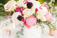 09 a modern and cool bridal shower centerpiece in a marble vase, with pink and white roses, black blooms and greenery is wow