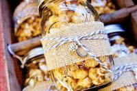 09 popcorn in jars, with burlap and twine is always a great idea of an eco-friendly wedding favor that is always to the point
