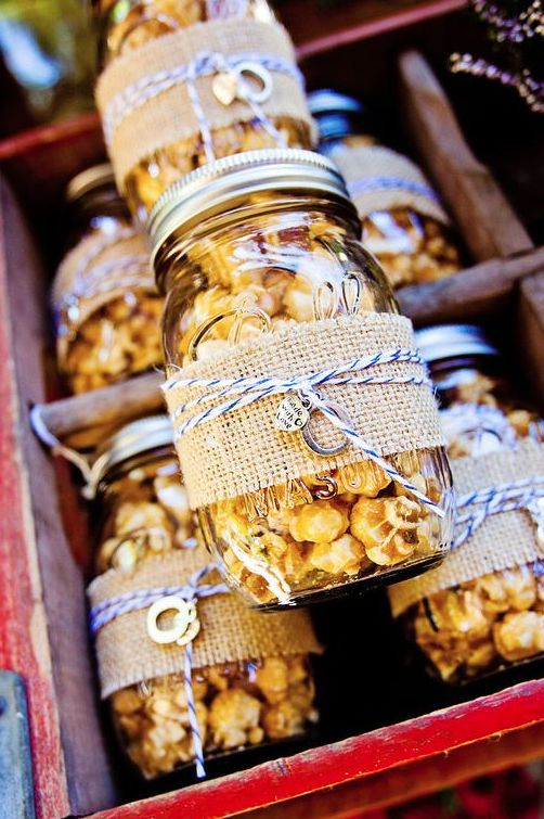 popcorn in jars, with burlap and twine is always a great idea of an eco-friendly wedding favor that is always to the point