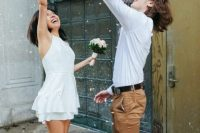 11 a mini plain wedding dress with a halter neckline and a layered skirt plus white sneakers for a modern casual bride