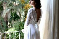 12 a modern and casual plain over the knee wedding dress with a cutout tied up back, long sleeves is ideal for a minimalist or casual wedding