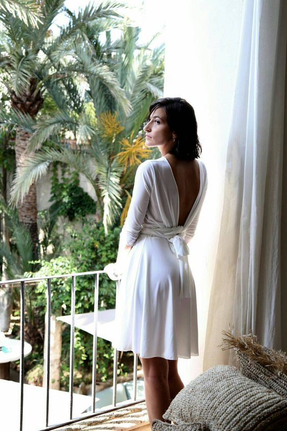 a modern and casual plain over the knee wedding dress with a cutout tied up back, long sleeves is ideal for a minimalist or casual wedding