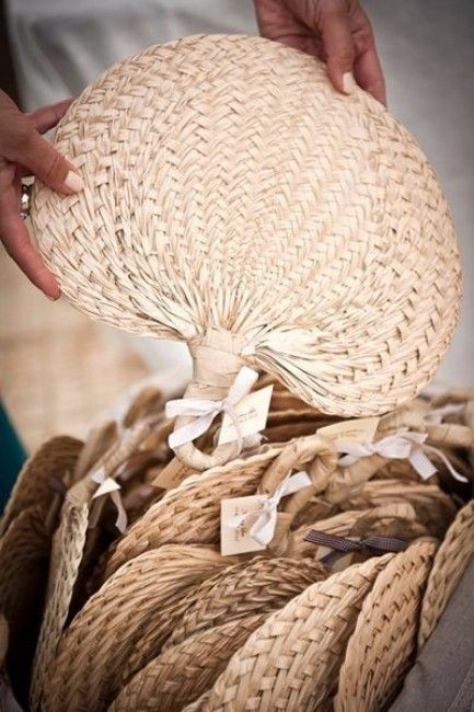 a woven fan is a great eco-friendly idea for a tropical wedding or just for a summer one and it will keep the guests cooler