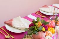 15 a modern colorful fall bridal shower tablescape with bright painted pumpkins, blooms and dip dye napkins