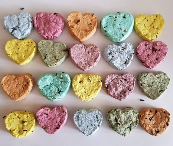 colorful wildflower seed bombs are made with recycled paper and contains wildflower seeds and will give pretty blooms to attact flies and bees