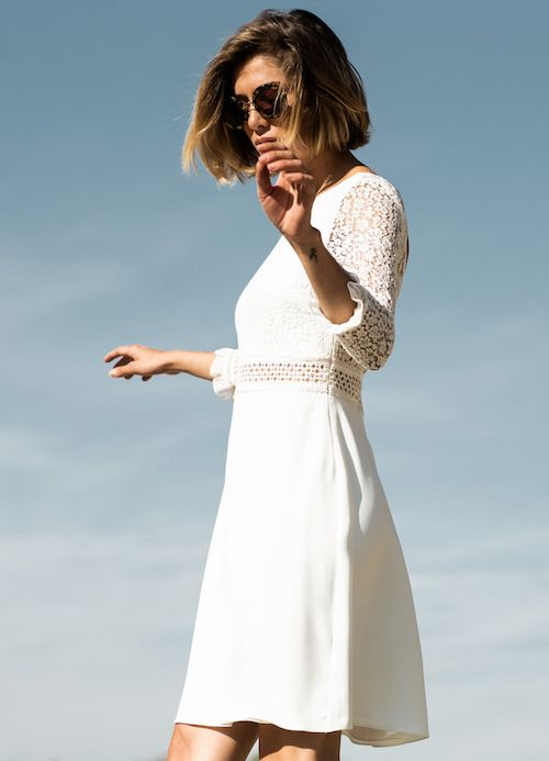 a simple and casual mini A-line wedding dress with a lace bodice and short lace sleeves plus a plain skirt for a modern bride