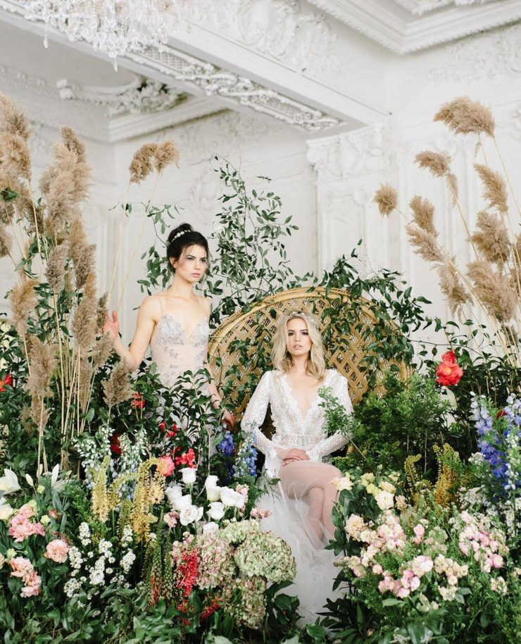 an indoor garden with lots of greenery and blooms plus grasses is a lovely idea for a flower-filled wedding