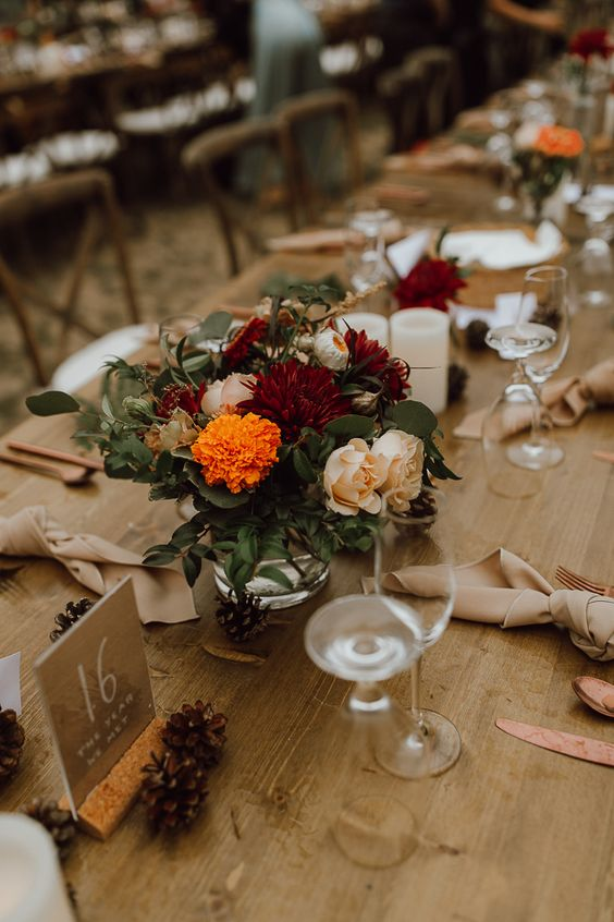 lovely fall rustic tablescape with bright blooms