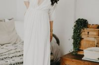 21 a casual A-line wedding dress with a depe neckline, short sleeves and a draped bodice and skirt is a lovely idea for a modern bride