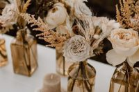 a cool fall wedding centerpieces with dried flowers