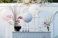 23 a spring blossom bar with blooming branches, cute balloons and cool drinks for a modern spring bridal shower