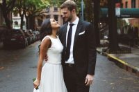 24 a casual sleeveless midi wedding dress with a plain bodice, a pleated skirt, blue heels for a chic and pretty bridal look