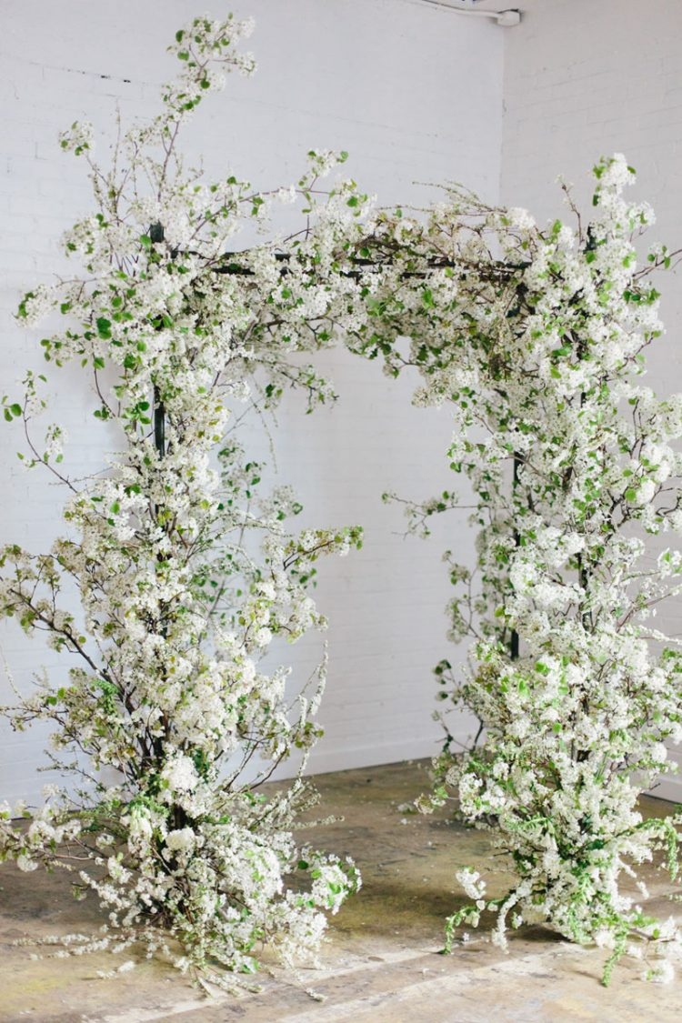 a jaw-dropping white blooming branches wedding arch is a gorgeous and absolutely amazing idea for a spring wedding